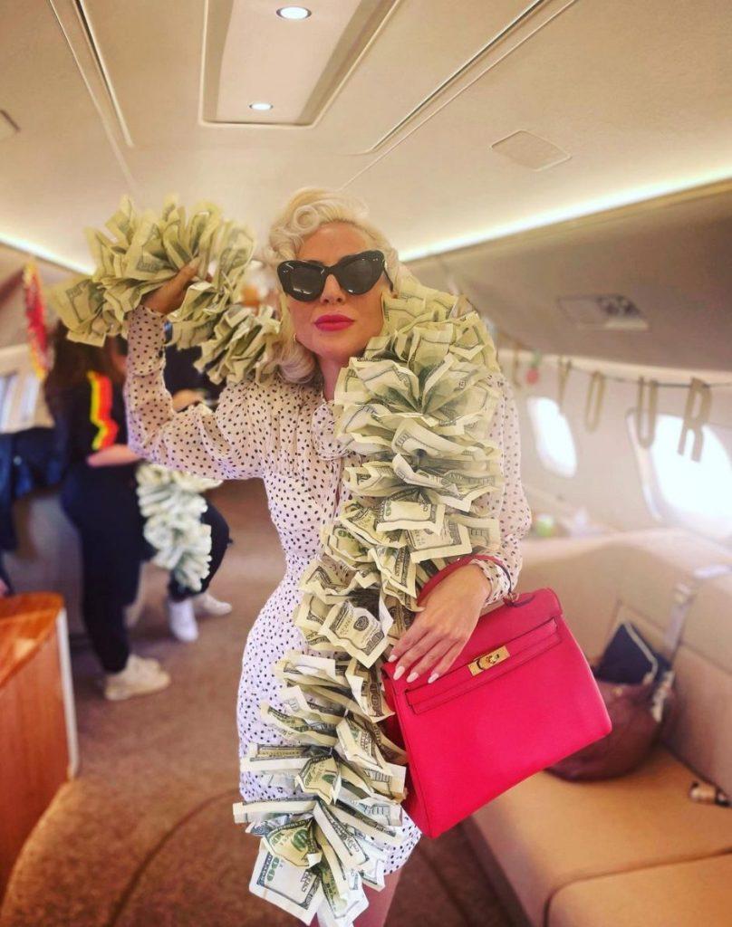 Lady Gaga money boa plane